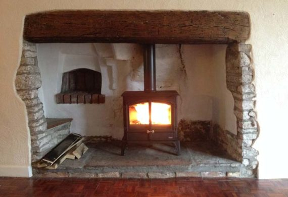 stove installed into a large fire place