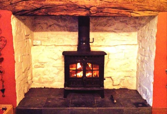 log burner installed into brick fire place