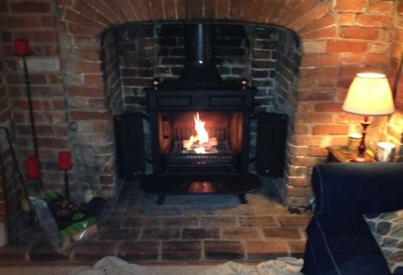 log burner installed into brick fire place