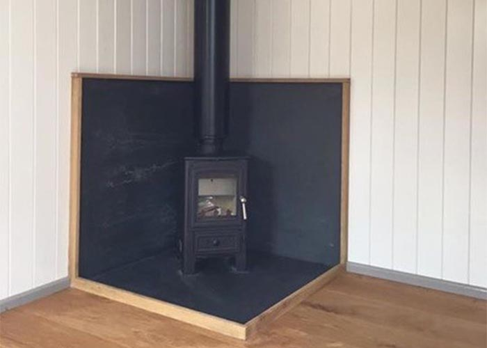 log burner in log cabin