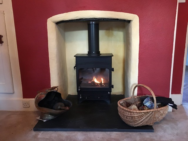 wood burning stove installed into traditional home